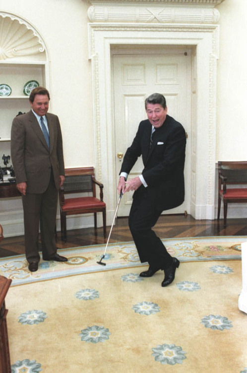 Happy Monday! President Reagan and golfer Raymond Floyd reacting after putting a golf ball in the Oval Office. 6/24/86. -from the Reagan Library, ID C35704-21