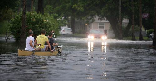 Residents navigate flooded streets in a canoe as flooding worsened and tropical storm Debby pounded the Tampa Bay area in Florida on Sunday  Photograph: Chris Zuppa/AP