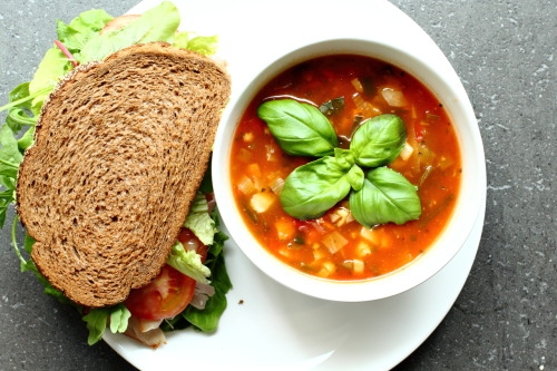 theroadtohealthyliving:  Lunch was a sandwich loaded with lettuce, alfalfa, cucumber, tomato, pickles, a slice of ham and mustard with a bowl of tomato soup