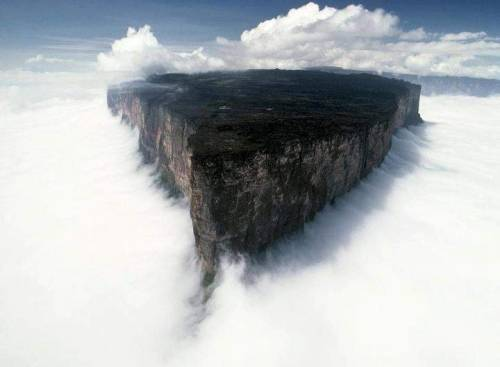 Fantasia can be whatever you want it to be …   Mount Roraima, Venezuela  The majestic Mount Roraima is the highest mountain in the Pacaraima Mountains. Roraima lies on the three borders of Venezuela, Brazil, and Guyana. The mountain is part of Venezuela's Canaima National Park, a UNESCO World Heritage Site. Angel Falls is also part of this beautiful park. Mount Roraima's highest point is Maverick Rock at 2,810 meters (9,219 feet), and the whole of Mount Rory fairly flat top surface area is surrounded by 400+ meter (1,312+ feet) high sheer cliffs. Mount Roraima can be climbed, though all routes besides the Paraitepui route require technical climbing gear. Visitors can get a stunning view of Mount Roraima and the greater Canaima National Park from a memorable helicopter ride.  Credit: Uwe George, National Geographic Society