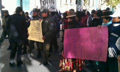 Bolivian police protest for higher wages in the Plaza Murillo, in front of the presidential palace.