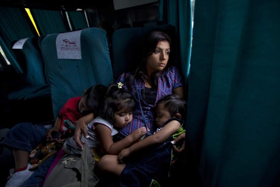 Marisol and her children endure a 28-hour bus ride from Mexico City to Dallas, Texas, at the end of her three week stay with her in-laws. Traveling by bus has become increasingly dangerous because of armed assaults, and she vowed never to travel this way again. Photographer Janet Jarman has documented the life of Marisol, a young Mexican immigrant, since she was a young girl still living in Mexico, more than 15 years ago.  See more photos here.