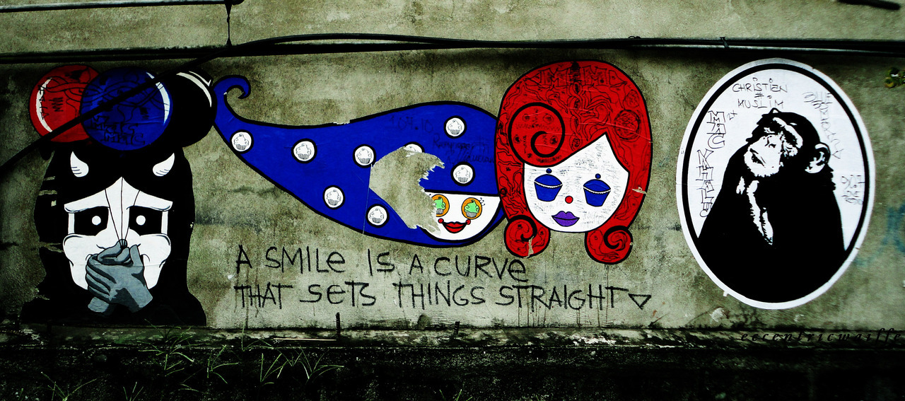"""a smile is a curve that sets things straight."" ponciano street, davao city"