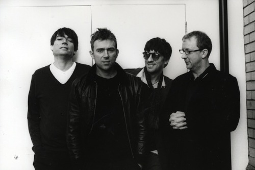 "Blur to Debut Two New Songs Live on Twitter…Performing ""Under the Westway"" and ""The Puritan"" for Live Webcast  The perpetual back-and-forth over Blur's future comes further into focus today. The band has announced that on Monday, July 2, at 6:15 p.m. BST, they'll perform two brand new songs, ""Under the Westway"" and ""The Puritan"" on a London rooftop. The performance will be available to watch through a live webcast via their official Twitter page. (More via Pitchfork…)"