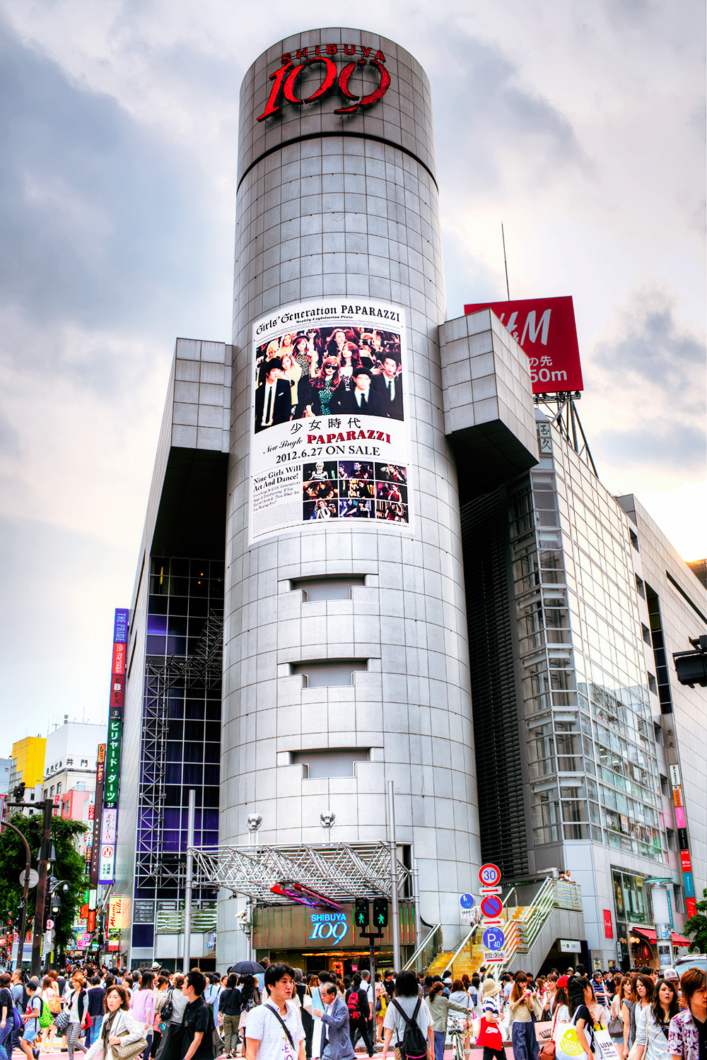 "Girls Generation ""Paparazzi"" billboard on the side of Shibuya 109."