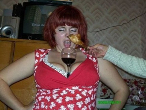 Woman with Wine in Cleavage and Chicken in Her Nose Dinner is hard.