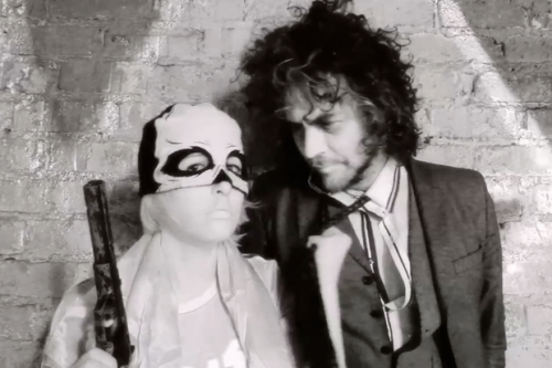 "See the Video Wayne Coyne Made With 'Weirdos' HOTT MT…  The members of Los Angeles psych-pop trio HOTT MT record under bizarre aliases, refer to their sound as ""Thai gaze,"" and seem to be inspired by the ""teachings"" of famous conspiracy theorist Milton William Cooper. (Their handle is an acronym for Hour of the Time Majesty Twelve) That's already enough crazy to make a band memorable, but Ashi Dala, Spooky Tavi and Bad Bahd had weirder aspirations still, so in January, they packed up their instruments and drove to Oklahoma City, timing their trip so that they'd arrive at Wayne Coyne's doorstep on the morning of the lead Flaming Lip's 51st birthday. They brought him a copy of their newly finished album I Made This and requested a collaboration. (Video and More via SPIN…"