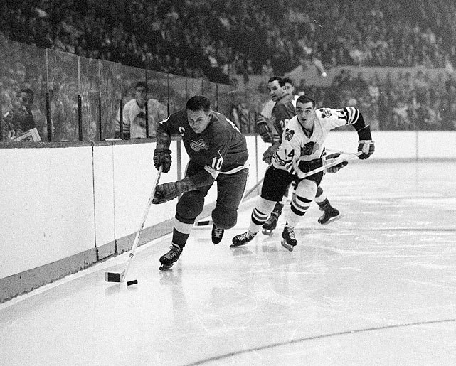 Alex Delvecchio advances the puck during semifinals of the 1966 Stanley Cup playoffs between Detroit and Chicago. The Red Wings would eliminate the Blackhawks in six games but would lose the Canadiens in the Finals. (Walter Iooss Jr./SI)  SI VAULT: Howe is the heart of the Red Wings (3.16.64)