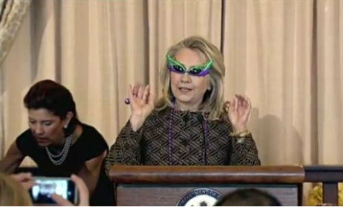 Secretary of State Hillary Clinton is beyond cool!  Sec. Clinton wore these purple and green cat eye sunglasses at the swearing in ceremony for Assistant Secretary Mike Hammer.