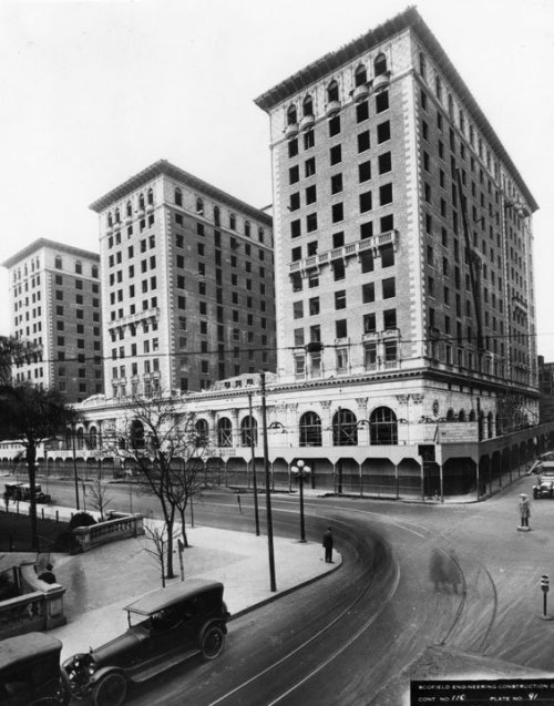 The Biltmore Hotel (Still under construction) & northwest corner of Pershing Square in 1923.  Note the traffic conductor in the middle of the intersection.