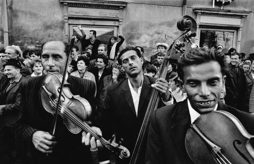 Josef Koudelka'Gypsies'Les Rencontres Arles Photographie02.07.2012 - 23.09.2012In 1975, the first edition of Josef Koudelka's photographs was published by Robert Delpire in a book that became a myth and was never published again. In 2011, Josef Koudelka exhumed a former dummy of the same book and decided to re-publish it with a larger amount of photographs. Exceptional pictures, exhibited for the first time together, unique prints, the show tells, through unpublished documents, the story of those two books published with a thirty-six-year gap.In the 1975 edition, Robert Delpire said about this special project that impacted the twentieth century history of photography: 'In the very stillness of the characters Josef questions and who question him, there is a kind of tension, a quivering, the muffled murmuring of flowing blood suddenly contained. It is not so much the temporary nature of immobility, the suspended time peculiar to the snapshot, as the feeling that this precarious immutability is only a surface phenomenon. Beneath each of these weather-beaten and hairless complexions silently glides the ice of all fears. Rooted like dried trees inside these bare, white walls, men mark out lines, indicate the masses of a statistically geometric order. Prisoners of the attention that they bring to bear, without naivety, on the photographic event, they are both witnesses and actors of their own presence. Whether they keep watch over the victim of a murder, show their pathetic treasures or flaunt themselves in front of Josef in the ironic ostentation of an accepted impoverishment, they give to the image its weight of classicism and tradition.'Robert Delpire, excerpt from 'Josef ou la fureur de voir', 1975. © Les Rencontres Arles Photographie