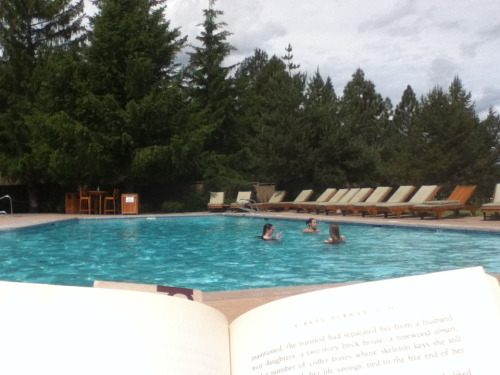 Relaxing at the pool with a book in sunny weather. Finally, it's summer in Oregon!