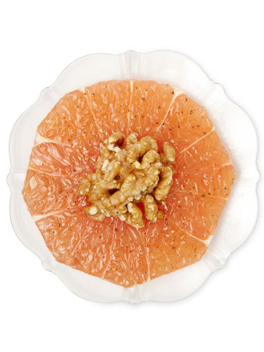 Gussied-Up Grapefruit  This favorite citrus fruit is already low-cal and bursting with wrinkle-fighting vitamin C. Add walnuts for healthy fats that help keep skin supple. To make: 1. Peel a grapefruit; cut into 1 ½-in.-thick slices. 2. Place walnuts in small bowl and microwave for 45 seconds to one minute. 3. Place five nuts, broken into halves, in the center of each slice and sprinkle with a pinch each of salt and ground cinnamon; a slice serves one.   Read more: Anti Aging Foods – Best Superfoods for Anti Aging - Good Housekeeping