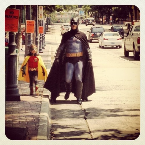 "deantrippe:  My friend, Batman, with his son. Seriously, dudes, Batman stopping by my table at HeroesCon to say hey to me was the coolest thing ever. ""Oh, that's my friend, Batman."" :)  This is an AWESOME Batman cosplay. Check out lil' Robin!"