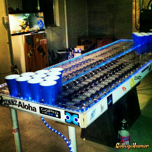 collegehumor:  Keystone Light Beer Pong Table 232 Keystone Light cans, 40 ft of blue rope light. Made by 5 college kids with spare parts from our garage. PVC pipe and house trim. Colorado swag. Drink to be productive.