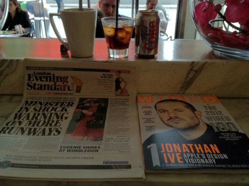 'Monday'  I'm sitting in the cafe with Jony Ive.  My Evening Standard is here also. Whatever.  Along with my cup of tea & diet coke with ice. Whatever.  But it's Jon who's got my full attention.  *Swoon*
