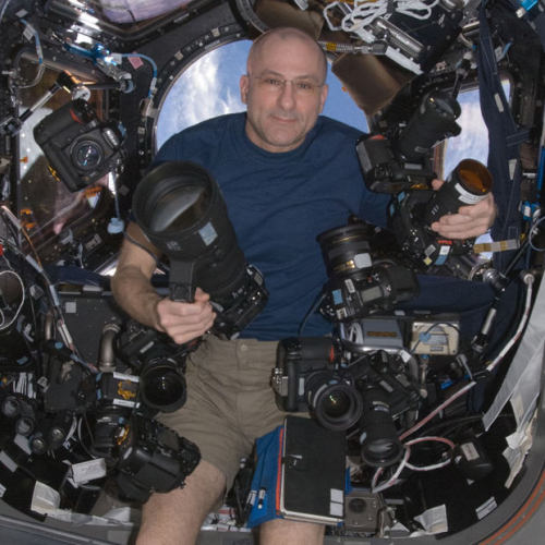 wnyc:  bobbycaputo:  Ever wonder what camera gear NASA astronaut Don Pettit uses to shoot his amazing photographs from the International Space Station? Here's a portrait of Don floating around on with his massive collection of Nikon DSLRs and lenses.  (Via. Petapixel)  I guess you don't have to pack light in zero G. —A.P.  WHOA. This picture elicits the same mixture of disbelief and awe as his space portraits.