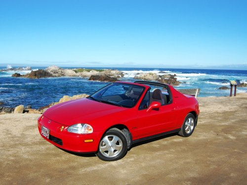"Honda Del Sol Welcome to the third installment of the ongoing series, will it be a Classic or Not? where I'll raise the question of whether a car will become (or already is) a classic. You can give a simple yes or no answer or answer however you like. Feel free to speak your mind! Today's question is the Honda Del Sol (a.k.a. Civic Del Sol & CRX Del Sol) which was built from 1992-1998. The name Del Sol means ""of the sun"" referring to it's targa top, 2-seat, roadster-esque layout. It was a funky, little car from a maker that hadn't had much funk in their lineup at the time. It had a front-mounted 4-cylinder engine and front-wheel drive, available in Si and SiR trim. In 1995, the Civic moniker was dropped in the U.S. and the Del Sol moniker was dropped from the European market and became solely CRX. In the first year, it sold just under 26,000 units in the U.S. and from then, sales decreased each year it was in production. In 1997, only 5,600 cars were sold totaling less than 75,000 throughout its run. Being popular among teenagers, they are prone to being tuned, mistreated, and crashed, so those numbers are quickly dwindling. The number of stock cars in decent shape is probably somewhere in the 20,000 range. So the question is, will it be a classic or not? Photos via David Clanton."