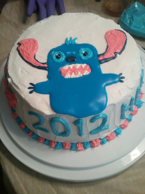 This year's birthday cake decoration: Domo-Stitch. Lesson learned: cookie icing isn't good for cake decorating.