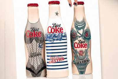 "Tattoo, Jean-Paul Gaultier's latest Diet Coke Bottle  Coca-Cola has just officially unveiled the ad campaign and visuals for the third bottle in the Diet Coke by Jean Paul Gaultier collection. 'Tattoo' showcases Jean Paul Gaultier's passion for body art and dresses the bottle head-to-toe in iconic designs reminiscent of his past catwalk collections.""Tattoo"" is available across nine European countries from June 2012"