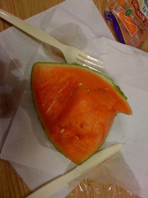 Eating this watermelon like it's steak, like it's nobody's business…and slurping the juice out of the canals that I'm making with my plastic utensils. I'm such an animal.