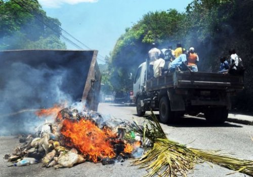 Hundreds protest Haiti government plan to destroy homes June 25, 2012 More than 1,000 Haitians marched through the Caribbean nation's capital Monday to protest a reported plan to destroy their hillside shanties for a flood-control project before they have found better, more permanent dwellings in the wake of a devastating earthquake. Police fired tear gas in an attempt to control the protesters, some of whom threw rocks. The demonstrators snaked through the Port-au-Prince metropolitan area chanting threats to burn down the relatively affluent district if the authorities flatten their homes. Source