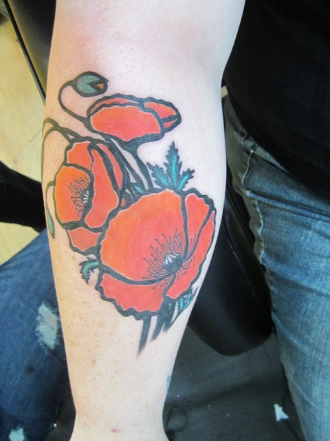 I got this tattoo yesterday (6/24) in Mackinaw City Michigan by the lovely and talented Ali Harfert. She's been my tattoo artist for years and she's awesome. I got poppies because they are my mom's second favorite flower. Her all time fav is roses, however I already have roses on my chest. So I got poppies because we both love them. It's my 15th tattoo and I absolutely love it. Ali did an amaaazing job.
