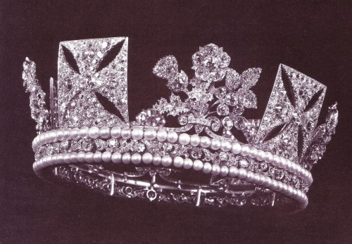 The King George IV State Diadem, was made in 1820 for the coronation of … well, King George IV. This huge and heavy diadem includes 1333 (!) diamonds and 169 pearls. The diadem was worn at the coronation of both Queen Victoria in 1838 and Queen Elizabeth II's in 1953. Her Majesty wears the diadem every year for the State Opening of the Parliament.