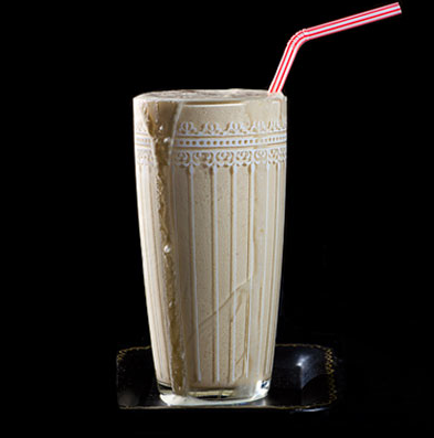 Peanut Butter Bourbon Milkshake MAKES ONE 12-OUNCE SHAKE  INGREDIENTS 2 oz. bourbon ½ oz. maple syrup ¼ cup crunchy peanut butter 1 cup vanilla ice cream 1 cup ice cubes  INSTRUCTIONS Combine all ingredients in a blender, and blend until fully incorporated and frothy.