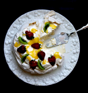 Pavlova 3 cups sugar 1 egg Juice and zest of 1 lemon 2 tbsp. unsalted butter, cubed, and chilled 1⁄4 cup cornstarch 1 tbsp. distilled white vinegar 1 tbsp. vanilla extract 8 egg whites, room-temperature 1 cup heavy cream, chilled 1⁄2 cup chilled plain yogurt Strawberries, halved Kiwifruit, peeled, and sliced For Recipe go |Here