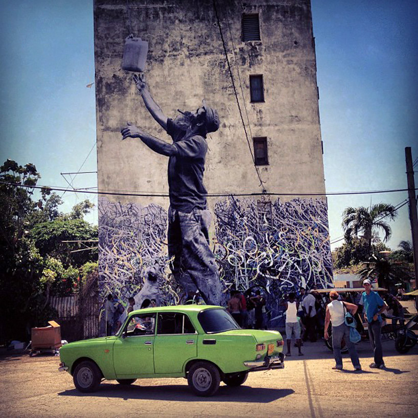"gezenbezgin:  havana lickystickypickywe:  From the Havana Biennial 2012 comes the collaboration of street artists J.R. and Jose Parla. Exploring the relationship between visuals and social issues, the French ""photograffeur"" and Cuban-American visual raconteur have transformed the streets of Havana with absorbing murals for their wall-revitalizing ""Wrinkles Of The City"" exhibit. Featuring the frenetic calligraphic gestures of Parla and the melancholic portraits of J.R., the fused work blends the two disparate styles into a melodious harmony. Parla's topographical notes give J.R.'s elderly subjects a dreamlike quality and the imperfect facades add texture while enhancing the depth and tactile quality of each image. (click on the images to see them bigger. Their work is wonderful)"
