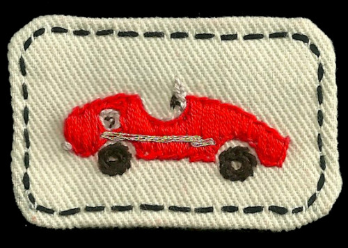 Our word was 'car'. A race car badge I embroidered.