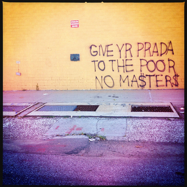 give yr prada to the poor. greenpoint. on Flickr.Gentrification has been a major issue in Greenpoint and Williamsburg for years. The class divide is apparent, especially with rents going sky high & condos popping up everywhere, so its no wonder why some are bitter. This was taken on West Street in Greenpoint & is reminiscent of Basquiat's street poetry written on city walls in the late 70s.