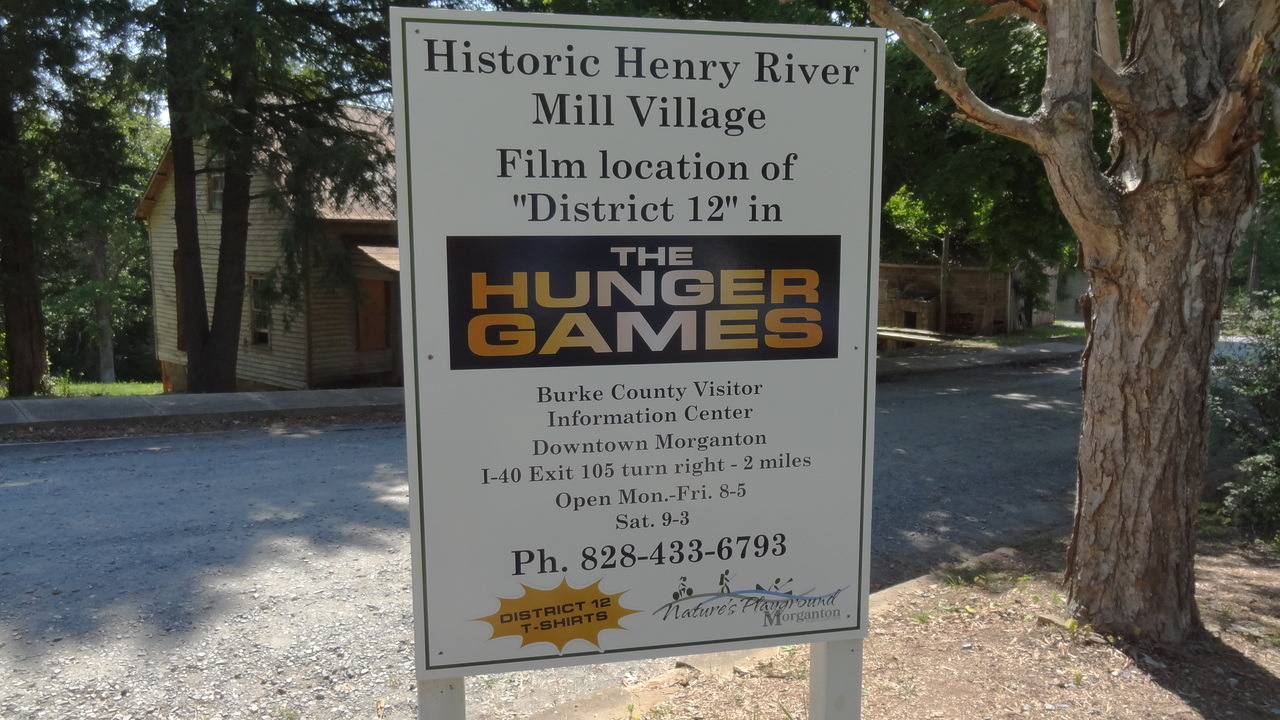 rhonniem:  District 12 filming location - Henry River Mill Village - Hickory, NC.   Come see the desolate, hopeless situation that brought The Hunger Games™ District 12's oppressed poverty come to life! There is literally nothing here in the Historic Henry River Mill Village but bleak devastation and ruin. The perfect place for a family vacation, Historic Henry River Mill Village will make you feel oppressed by a tyrannical government! Visit today!