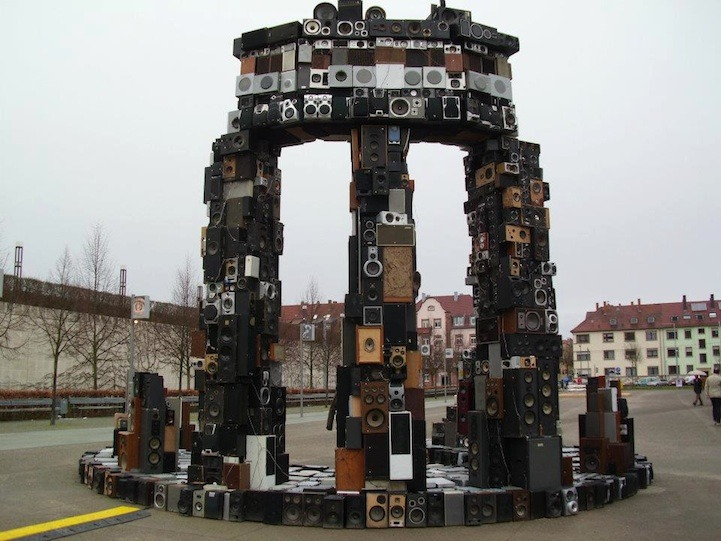 "ianbrooks:  Speaker Henge by Benoit Maubrey Showing for the current Sound as a Medium of Art exhibit in Germany, ""Temple"" was fortified with 3,000 recycled loudspeakers, 10 amplifiers, and 10 radio/tuners all wired up to one mixing board. Inspired by the Greek Old Temple at Delphi, though I'm more inclined to worship here. John Cusack reportedly tried to lift this over his head and was immediately crushed to death.  Artist: website (via: stantonwarriors / mymodernmet)"