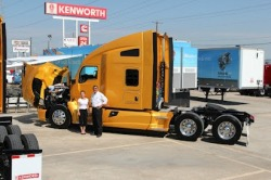 "MHC Kenworth of Dallas Sales Gurus: Darcy Saner and Nick Vermet. Posing for a quick photo during a last minute walkaround before the event. If there is one thing that I've learned during my stint out here on the road, it's that surprises are always expected, sometimes prepared for and never completely avoided. But then again, you're probably assuming I'm talking about unwelcome surprises. It's true, they are inevitable. Whether it's a road raged driver, a last minute broken display piece, a longer night than expected, a drowned blackberry or a two day old dashboard banana for dinner, trucking and showing off is a Super-Neodymium-Surprise-Magnet. As I sit here writing this wrap-up of the Dallas Kenworth event, I find myself reflecting upon my experiences out on the road, the dealer lots, and in the spotlight with customers, thinking about all of the good surprises I've had.  Dallas has been no different than any other stop we've made. The grounds were impressive, the people sharp and welcoming and the trucks cleaner than a surgeon's scalpel. What Dallas reminded me of, was that this isn't just a sleek, beautiful piece of machinery with class leading comfort, a swiveling passenger's seat, heated and cooled seats, double bunks and luxury car like panel gaps. It's a tool, and to some, that's all it is. They don't care if it has a square emblem or a round one, two exhaust stacks or one, four cupholders or none. If it gets the job done with drop dead reliability and efficient operation, it's a winner. In Texas, like when you're out on tour, that's what it's all about: give me the toughest, fastest, hardest working piece of equipment you can find. Where I'm going, it's hot, dirty and bumpy and it probably needs to go a long way to get there. And that's just what we did. After driving 4,000 miles around three quarters of the entire United States, we arrived in Dallas without a single schedule hitch or service shop visit. If you've driven from Alabama to Texas through Louisiana and Mississippi you'd understand how hot and bumpy life is down here. ""On-duty Airborne"" is a section in your driver logbook. I had some very interesting conversations at the MHC Kenworth event, many of which were with some die-hard fans. One of them was not. I will leave his name out of this article, because in a very short time, he may not want to explain why he once stated that the emblem on the hood of his trucks didn't make a difference to him. Let's call him surprised John. Surprised John wasn't apparently invited to this event, instead he walked in off the street when he saw the trucks and trailers displayed in the MHC parking lot. Little did I know, John owns 400 trucks. Many of his teams run 30,000 miles a month, with combined vehicle weights of approximately 50,000 pounds. Little did John know, I had something of interest to him. John and I spent some time comparing combined vehicle weights, mileage and average speeds, and we realized we had more in common than we thought. Our trucks run a very similar duty cycle. In John's bible, mileage is the first and only verse. Upon hearing my calculated mileage reports from the first few legs of the tour, he wanted a truck as fast as he could get his hands on it. When you're driving 400 trucks 30,000 miles a month, just a few tenths of a mile more in fuel economy will buy you another truck in no time. When the MHC Dallas crew was done, he had a month long no strings attached demo truck and a chance to prove himself wrong. We'll be in touch, John.  ""Over 40 mph, aerodynamics play a part. Even for ovewidth loads."" When I think about this truck, I get caught up in the details; the comfortable chairs, the versatile interior, the 4 cupholders in the forward cabin and the Bluetooth stereo. When you walk someone through the tour trailer, it's easy to show them all the features of this truck. What's more difficult, but what the MHC Dallas folk seriously ""get"", is that the T680 will prove itself worthy in any application. We had more people come through this tour trailer than I have seen in a while, and the MHC Kenworth sales crew was always one step ahead.  One pass through this trailer and you'll know what the T680 is made of, and boy did we pass through the trailer.   I think the heat had something to do with it, but then again I'm not from around these parts. The trailer is a fun, self-guided Exploratorium for some, or if you catch me twiddling my thumbs, an hour long top to bottom feature extravaganza for others. Dallas was no exception.  I was glad to have eaten lunch early, because I didn't escape for long. MHC Kenworth brought in some awesome barbequed burgers, beans and coleslaw. I don't know what they put on the buns (I'm guessing a lot of oil, butter and herbs), but these things were amazing. As much as I like pulled pork sandwiches, these were a very nice reprieve.  Beating the crowds, an early lunch. Dallas is a wrap and I'm off to Phoenix, Arizona for my final tour stop with these trucks at Inland Kenworth. I can't believe this tour is almost over for me. I've met so many great people from all walks of life, and I just added another 50 Texans to that list. They were exceptional hosts, friends and students. I'm happy to have brought something to their table as well. When all was said and done, we packed up. Three guys, 3.5 hours, 95 degrees, 50% humidity, a bag of sea salt and vinegar potato chips, a cooler full of ice water and my submerged blackberry, and this:  I love my job. Peter"