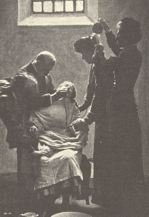 A suffragist (possibly Emmeline Pankhurst) on a hunger strike, being forcibly fed with a nasal tube at HM Prison Holloway, Islington, London, ca. 1911.