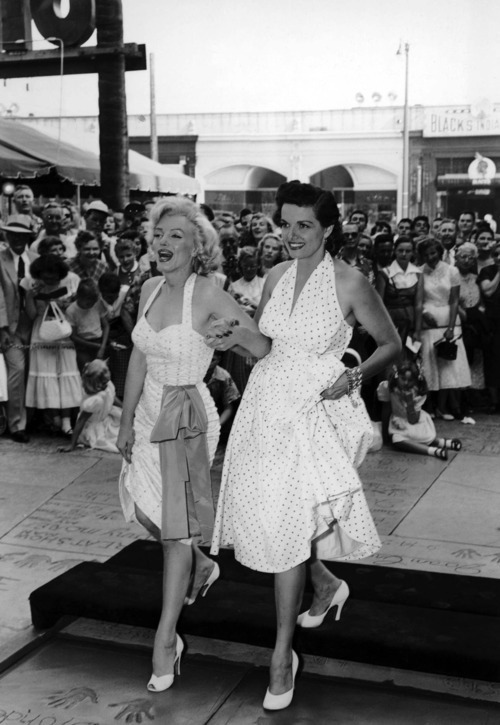 Marilyn Monroe and Jane Russell in 1953, both wearing classic white polka dot dresses
