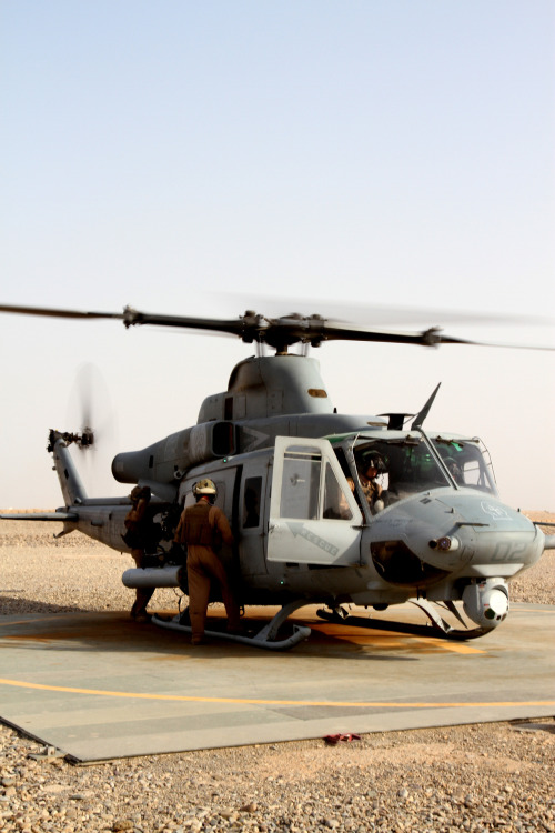 An air crew with Marine Light Attack Helicopter Squadron 469 preps its UH-1Y Huey for return to Camp Bastion, Afghanistan, June 20. Hueys and AH-1W Super Cobras are typically used to provide close-air-support because of their ability to provide heavy firepower and 360-degree security. Read more: http://www.dvidshub.net/image/611433/fighting-irish-deployed-crew-chief-fulfills-dream#.T-mGg3BXAVk#ixzz1ytMWQjIr