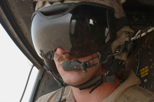 Lance Cpl. Seamus Clarke, a crew chief with Marine Light Attack Helicopter Squadron 469 and Binghamton, N.Y., native, watches buildings below for potential insurgent activity in Helmand province, Afghanistan, June 20. The squadron performed aerial reconnaissance in the area, ensuring Marines on the ground remained safe from enemy attack. Read more: http://www.dvidshub.net/image/611430/fighting-irish-deployed-crew-chief-fulfills-dream#.T-mIPHBXAVk#ixzz1ytNLCcsR