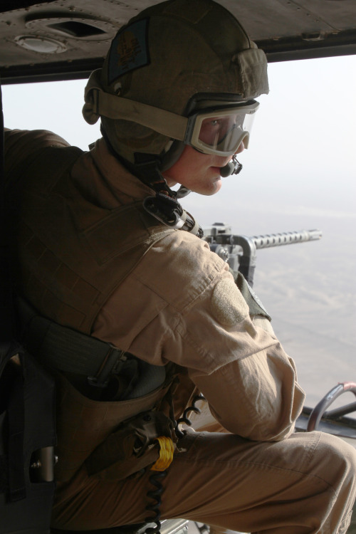 Staff Sgt. Robert Wise, a crew chief with Marine Light Attack Helicopter Squadron 469 and Daytona Beach, Fla., native, mans a .50-caliber machine gun over Helmand province, Afghanistan, June 20. The squadron provided close-air-support for a troop insertion as well as aerial reconnaissance in the southwestern region. Read more: http://www.dvidshub.net/image/611426/fighting-irish-deployed-crew-chief-fulfills-dream#.T-mIg3BXAVk#ixzz1ytNXXwLb