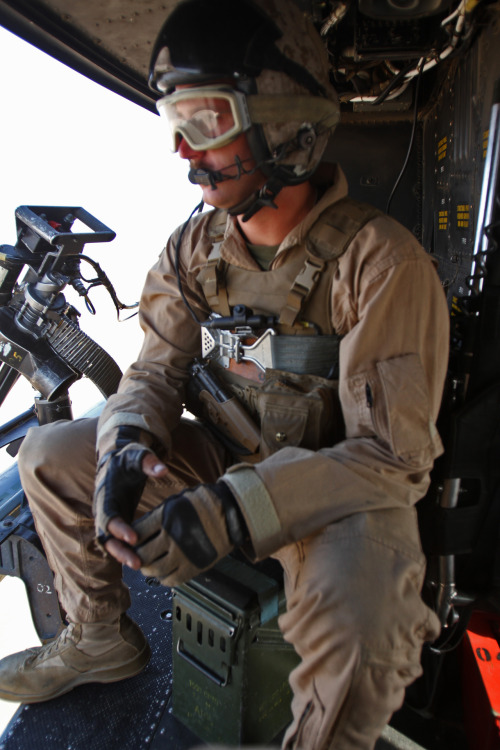 Lance Cpl. Seamus Clarke, a crew chief with Marine Light Attack Helicopter Squadron 469 and Binghamton, N.Y., native, performs aerial reconnaissance over Helmand province, Afghanistan, June 20. Clarke is on his first deployment and said being a UH-1Y Huey crew chief has been the best experience of his life. Read more: http://www.dvidshub.net/image/611422/fighting-irish-deployed-crew-chief-fulfills-dream#.T-mI-HBXAVk#ixzz1ytO2ZRAX