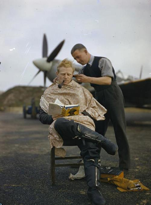 This unidentified RAF pilot reads while getting a trim.