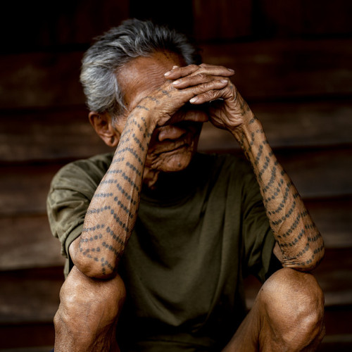 Old, sick, blind and former tattooed slave. Enough? Laos by Eric Lafforgue on Flickr.