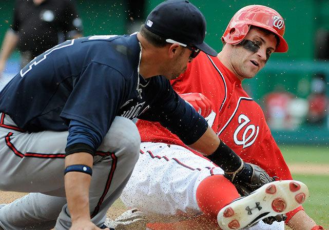 Martin Prado tags out Bryce Harper at third base as he attempts to stretch a double during a Nationals-Braves game earlier this month. Washington is ranked No. 2 in this week's SI Power Rankings while the Braves fell from No. 15 to 17. (Jonathan Ernst/Getty Images) POWER RANKINGS: Find out where your favorite team ranksGALLERY: The Phenomenal Bryce Harper