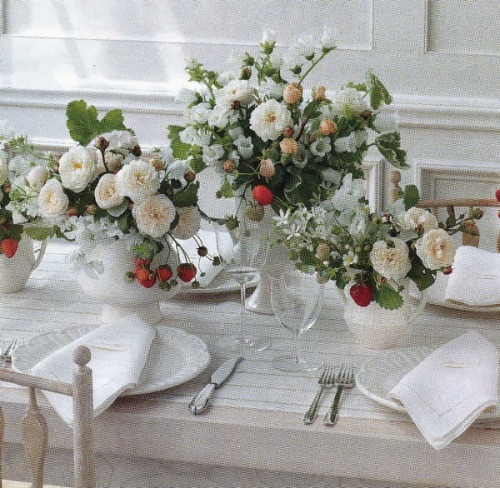 Use fresh fruit like strawberries to add interest to an all white arrangement