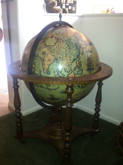Dude finds a mini-bar in his grandfather's old globe!