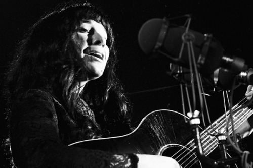 "Buffy Sainte-Marie Interviews on Democracy Now and CBC Radio  By: Eugene Boulanger   Gemini and Juno award-winning Cree singer-songwriter Buffy Sainte-Marie recently sat down with Democracy Now to talk about the origins of her love for music, her early family life, and her life as an activist. CBC Music documentary maker Philip Coulter also recently honored Sainte-Marie and her nearly 50 year-long career with a piece created from over 30 years of archived interviews with the singer, songwriter, visual artist and activist. Originally from the Piapot Cree Indian reserve in the Qu'Appelle Valley, Saskatchewan, Canada, she was raised in Wakefield, Massachusetts, before being welcomed back to the Piapot Cree during a Pow Wow ceremony in 1964. During the course of her career, Buffy Sainte-Marie has received honorary Doctor of Laws and Letters degrees from a variety of reputable institutions such as the University of Regina in her home territory of Saskatchewan, and Emily Carr University and the University of British Columbia in Vancouver, BC, among others. In the last 48 years she has put out eighteen albums. Buffy Sainte-Marie has been covered by Donovan, Joe Cocker, Neil Diamond, Giovanni, Janis Joplin, Courtney Love and many others. During these two interviews, Ms. Sainte-Marie recalls memories from the 1960′s era of grassroots social movements, when she was just beginning her career as a traveling singer-songwriter. At that time, Ms. Sainte-Marie was traveling to cafes and campuses around North America, writing and performing songs that weren't typically found in mainstream music which, as she describes them, were ""original to me, but an absorption and a reflection of what I was seeing on the streets and in college campuses."" It was a time when reactionary political activism in resistance to the Vietnam War and other political injustices had spread throughout student unions and subcultures across North America. Many artists had taken stances on political issues – John Lennon and Yoko Ono, Bob Dylan, and many others began using music to speak out against corruption and human rights violations being perpetrated by both foreign and domestic governments. On the show, Ms. Sainte-Marie performs her 1964 anthem Universal Soldier, a song portraying anti-war sentiment sewn through and through which speaks to the political climate at that time. ""I wrote Universal Soldier in the basement of The Purple Onion coffee house in Toronto in the early sixties. It's about individual responsibility for war and how the old feudal thinking kills us all."" It is inspiring to hear Ms. Sainte-Marie speak of her convictions and her motivations for being onstage, as she tells Democracy Now that it was always the messaging in her music that she felt protected by and which gives her the confidence to be on stage. She describes her motivation for writing Now That The Buffalo Is Gone, a song written during the Seneca Nation's battle with the United States in its effort to build the Kinzu Dam, which would eventually flood their traditional territories and force hundreds of Seneca to relocate from 10,000 acres of land they had occupied under the 1794 Treaty of Canandaigua. Ms. Sainte-Marie acknowledges the unbalanced and often biased perspectives offered by mainstream media as a motivating factor in writing the song, which speaks to the damage that misrepresentation can cause in relations between First Nations and surrounding national governments – a challenge which sounds all too familiar 50 years later. This author has grown up hearing the songs of Buffy Sainte-Marie from the tops of kitchen tables in many family member's homes, and for that reason, it is an honor to present this article and these two interviews for RPM's readers. Enjoy. Watch: Buffy Sainte-Marie on Democracy Now, Part 1 at RPM.fm  In the course of creating the documentary Still This Love Goes On: The Songs of Buffy Sainte-Marie, Philip Coulter listened to literally hours and hours of the CBC Radio interviews the songwriter gave over the past 30 years. Coulter reacquainted himself with Sainte-Marie's body of work (eighteen albums since 1964) and had his own face-to-face interview with her in Calgary this past April. To listen to Still This Love Goes On: The Songs of Buffy Sainte-Marie by Philip Coulter at CBC Music, click here."