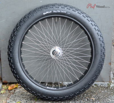 undergroundvelo:  Phill wood prototype 64 spoke fat wheel build. It looks like they drilled opposing holes into a surly clown shoe rim.