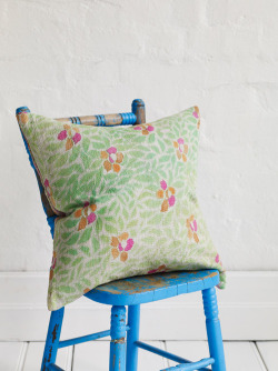 We love everything about this chair and pillow combo from The Family Love Tree.